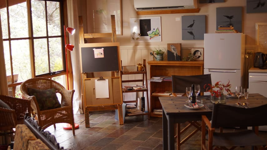 Step into a lovely sunlit, cathedral-ceiling livingroom and kitchen area and be wowed by the artist's corner - all ready for you to start painting or sketching!