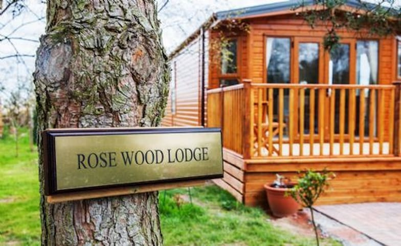 Rosewood, family friendly hot tub lodge on Felmoor, Northumberland.  Stylish and cosy with a touch of luxury.  Dog friendly too
