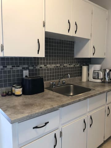 Newly renovated kitchen with plenty of countertop and cabinet space.