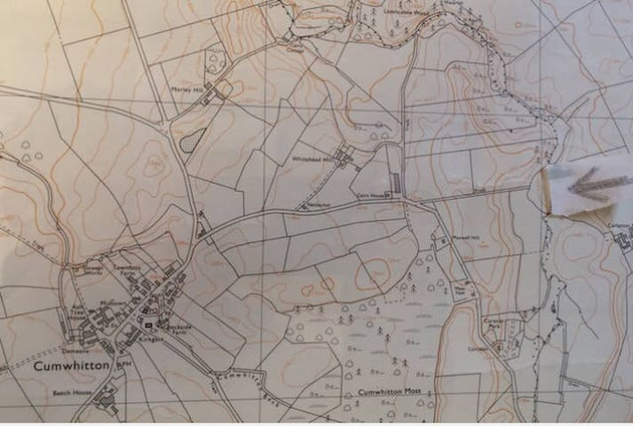 Arrow indicates log cabin. One mile east of cumwhitton