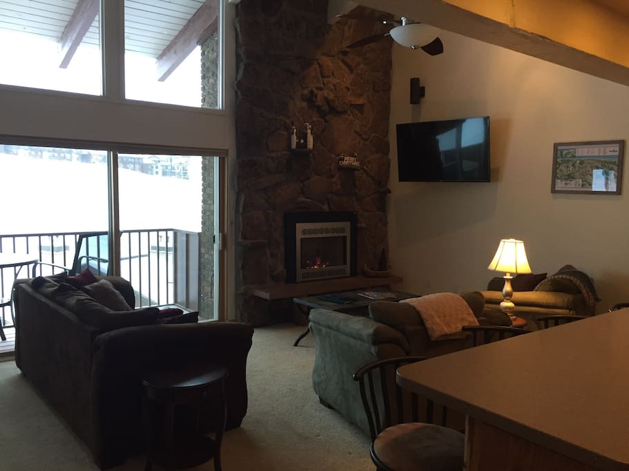 "22' Moss rock fireplace, with 55"" TV and gorgeous view of Ski Resort"