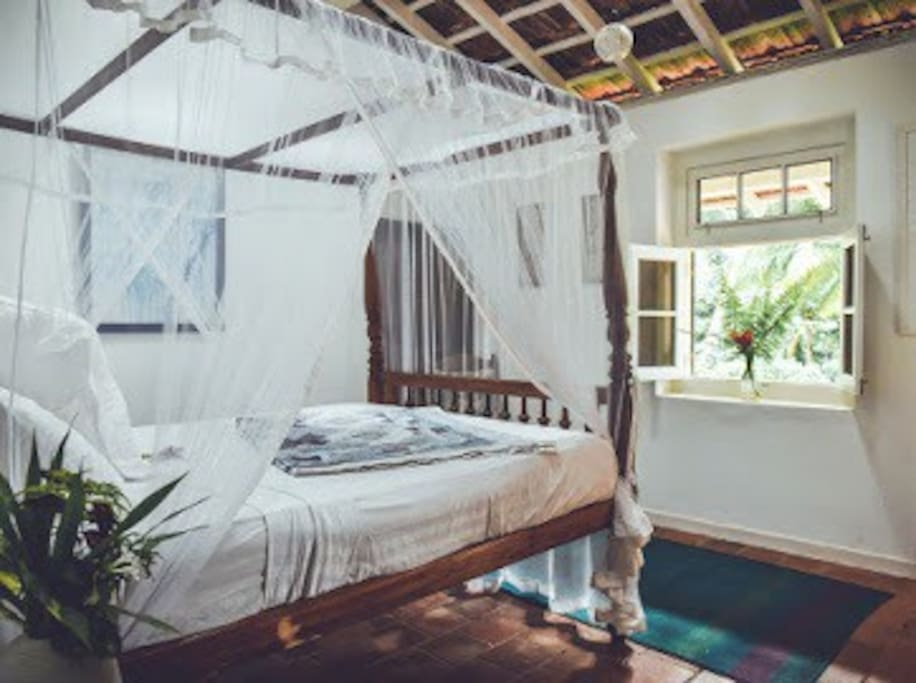 Navy room with garden view, private ensuite and mosquito net. Light and Airy. Ideal for Couples.