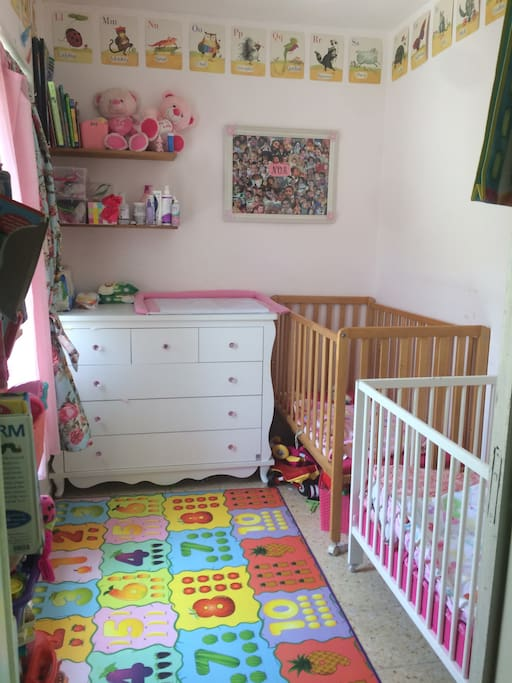 Second bedroom - ideal set up for small children, but crib can be removed and rearranged with American mattress to sleep 1-2