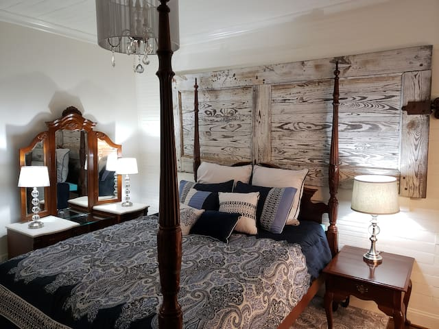 Master bedroom.  The barn door came out of the old cotton mill in Canton, GA.