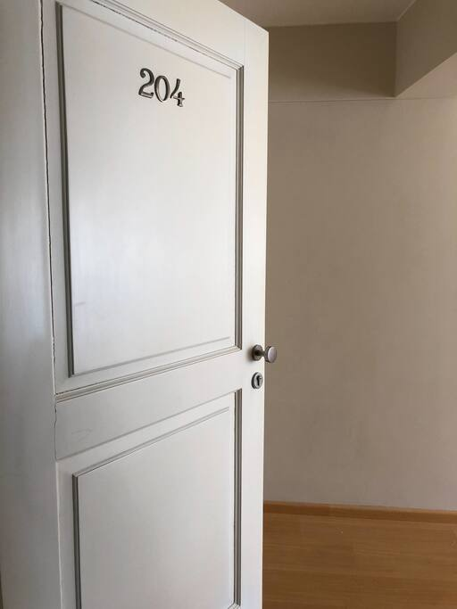 Puerta de entrada al Departamento que se encuentra en el piso 2.