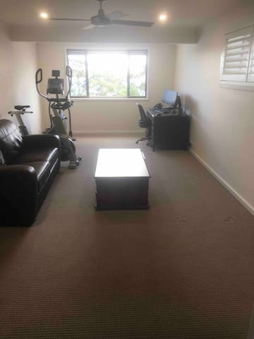 Second living room with sofa bed, extra office space, elliptical trainer and bike