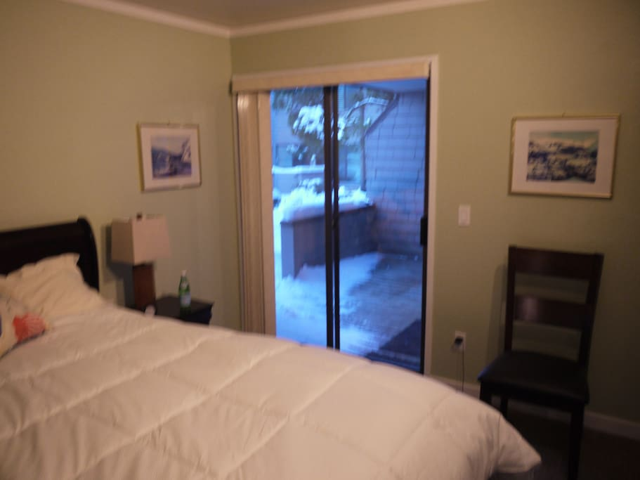 Master bedroom with view of deck