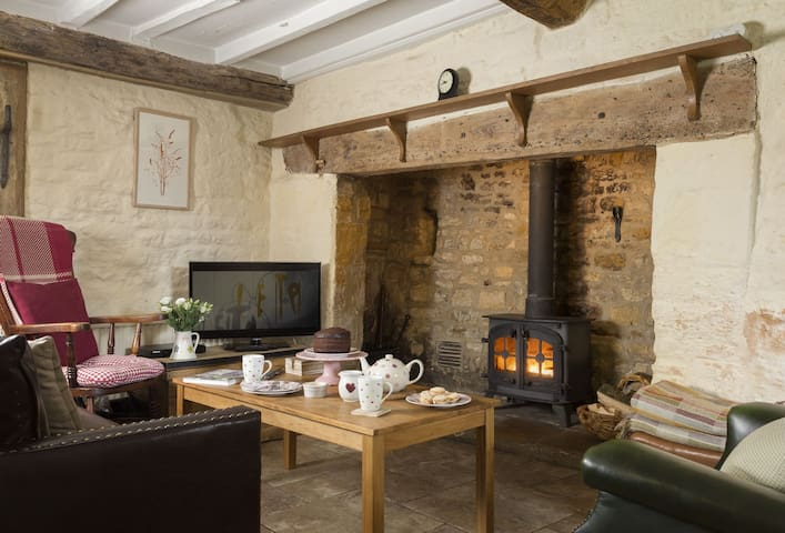 Living room area and inglenook fire place - relax by the log burning stove