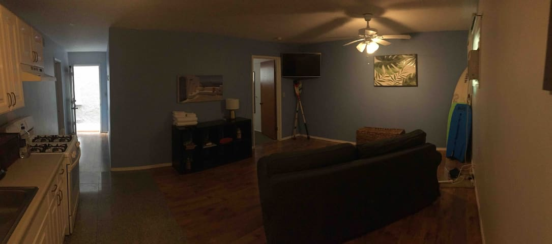 Panoramic of the living room and entrance