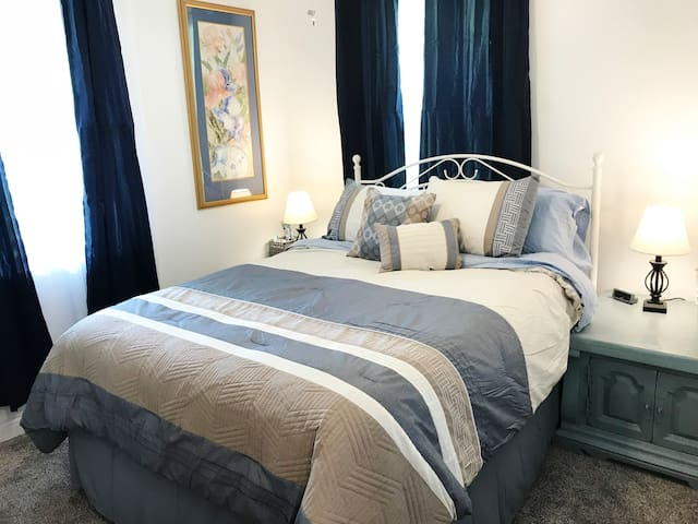 The Blue Room features sophisticated artwork and upscale linens for your comfort and enjoyment!
