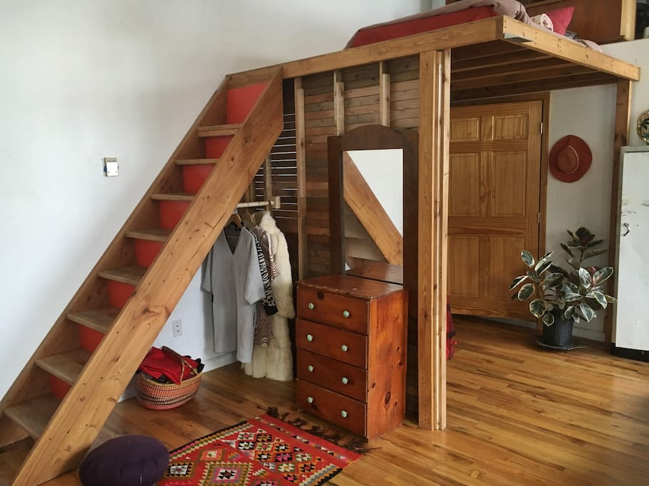 Lofted double bed, closet, and drawers