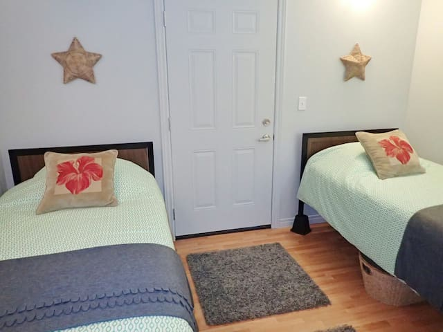 Two comfortable twin beds in the cozy second bedroom