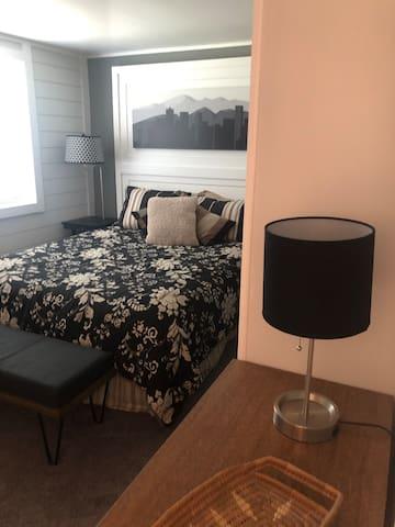 Large bedroom nicely furnished.