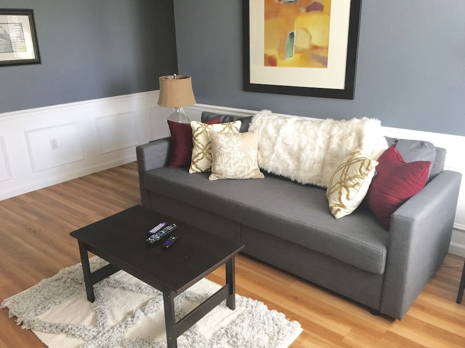 Comfy IKEA queen-size pull-out sleeper couch in living room