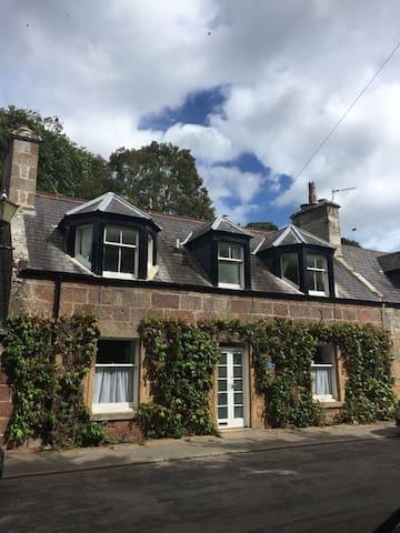 Quaint, traditional stone cottage.