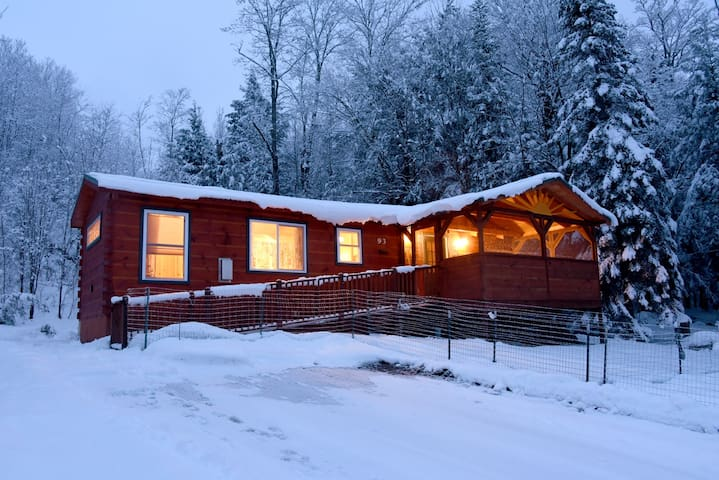 Welcoming cabin in the snow.