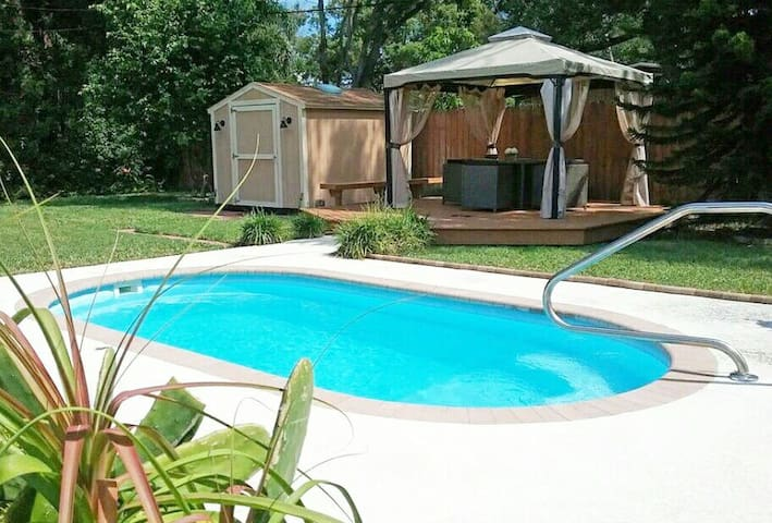 Take a dip in this inviting pool or relax under the shady gazebo