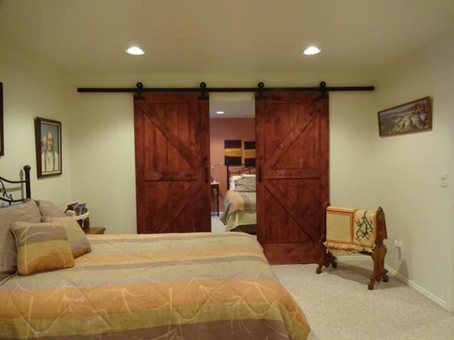 Barn doors seperate the rooms for privacy