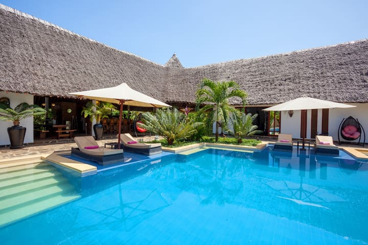 Villa Raymond central area with pool and sunbeds