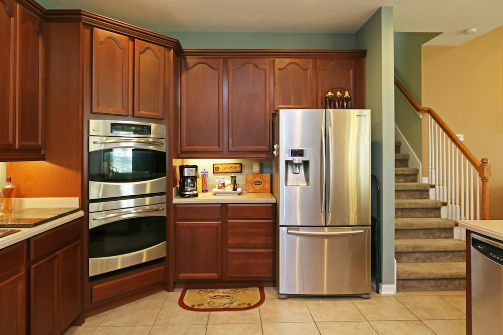 Gourmet kitchen with double oven Wolf flat-top range. Coffee and tea bar.