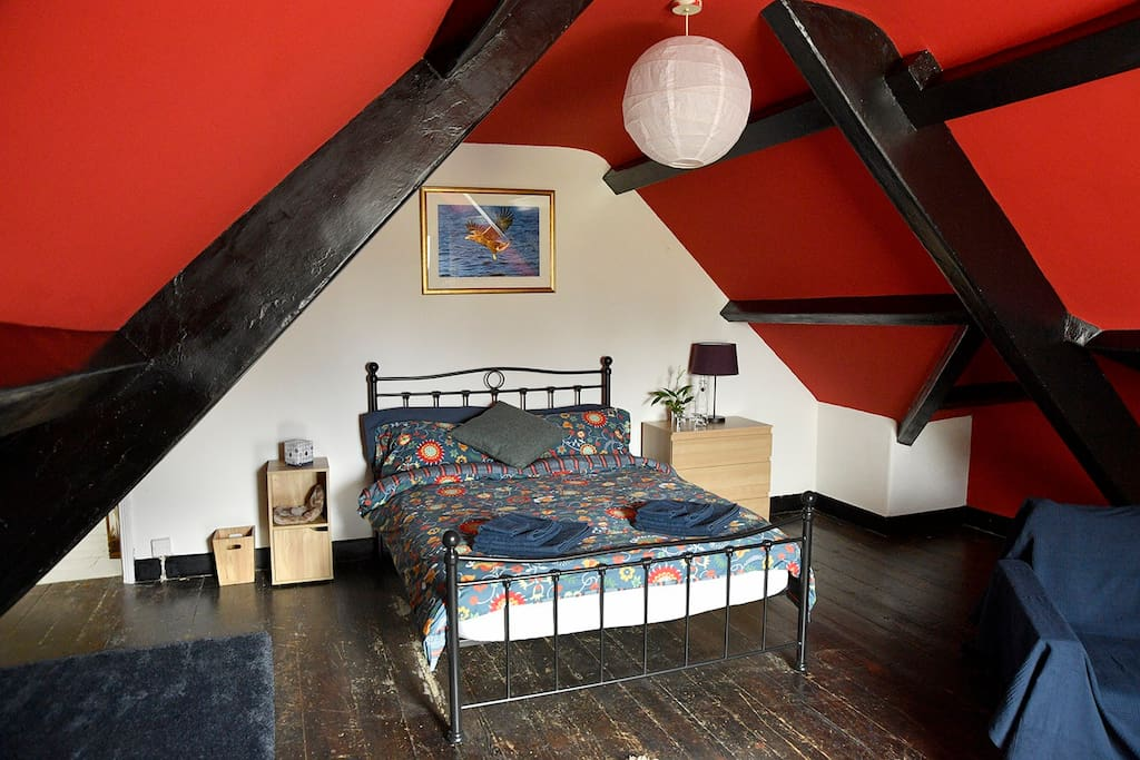 The courtyard room is a large bedroom in the eves of the house (mind your head)
