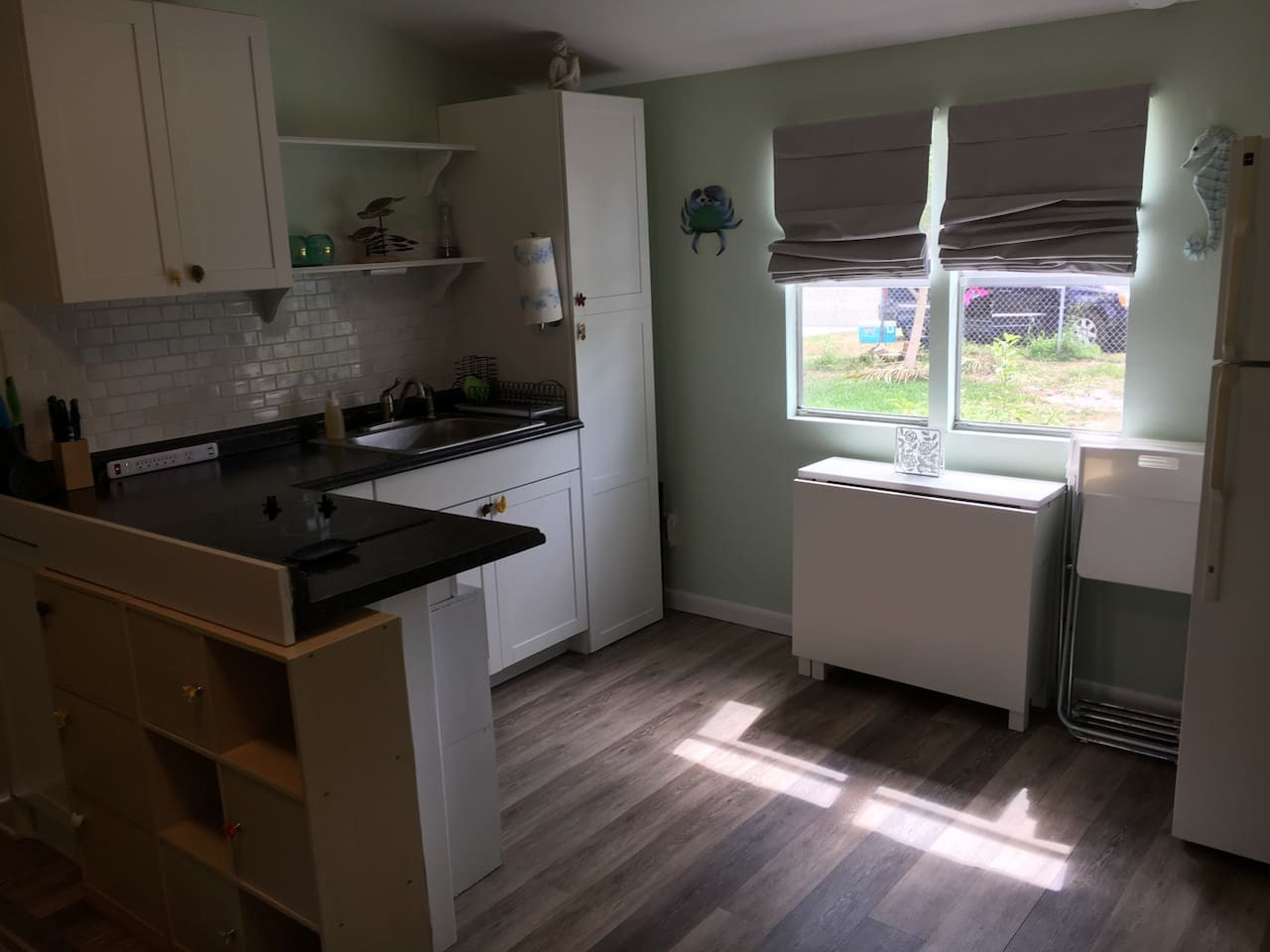 Kitchenette has large sink, full sized fridge, stovetop range, and large portable oven (large enough to fit a whole chicken in). Cooking utensils, cups, silverware and basic spices provided for you.