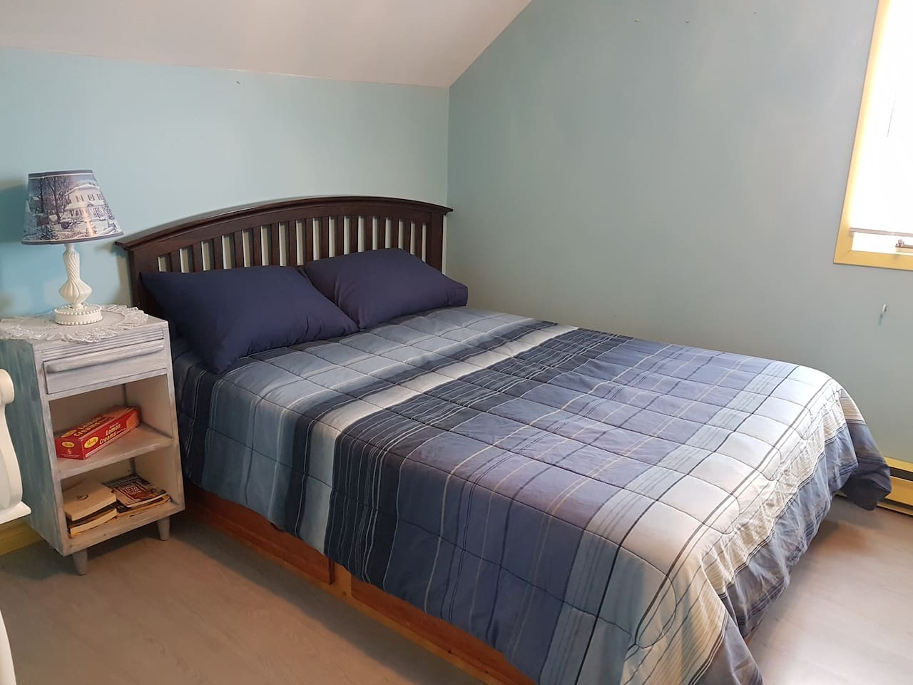 Cozy homemade double captain's bed with a beautiful ocean view of Notre Dame Bay!