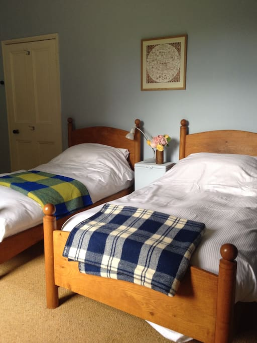 Twin beds with Egytian Cotton bedding and Welsh Wool Blankets