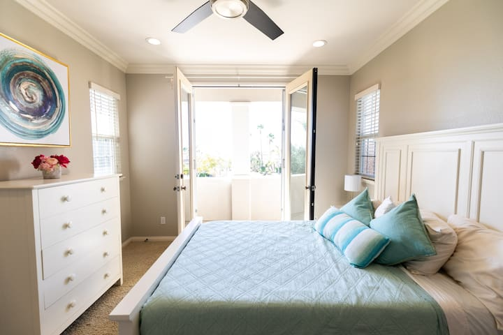 Queen size bed with attached full bathroom and walk in closet