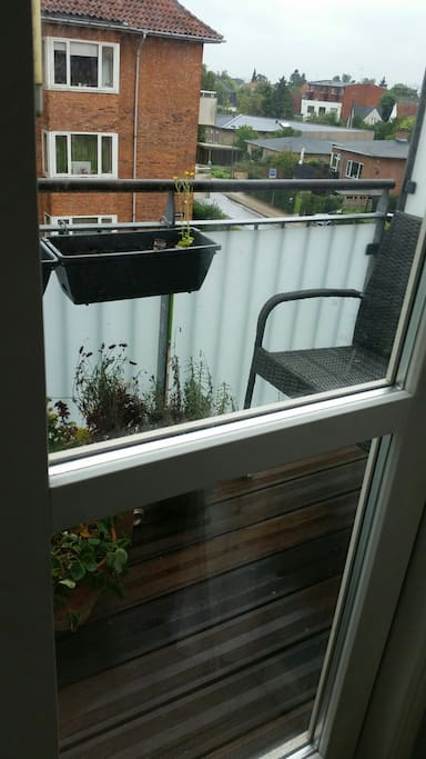 Balcony with plants and chill out corner