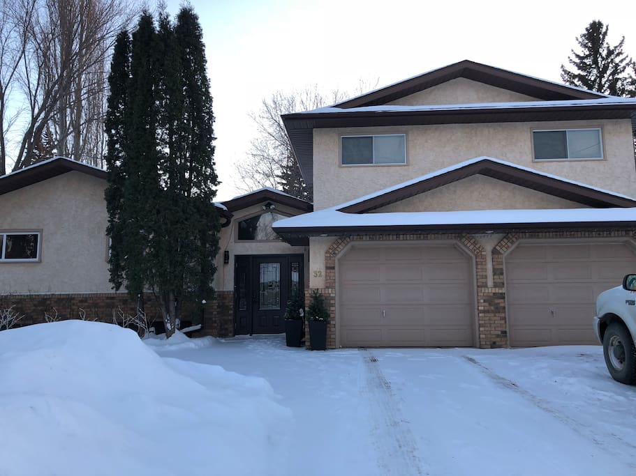 Front of the house, the suite is above the garage with entrance from inside the house and a separate entrance from the back yard.