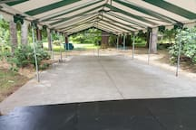 80X20' Tent included, capacity can seat up to 80 chairs, 10 round tables seating 8/table, not provided.