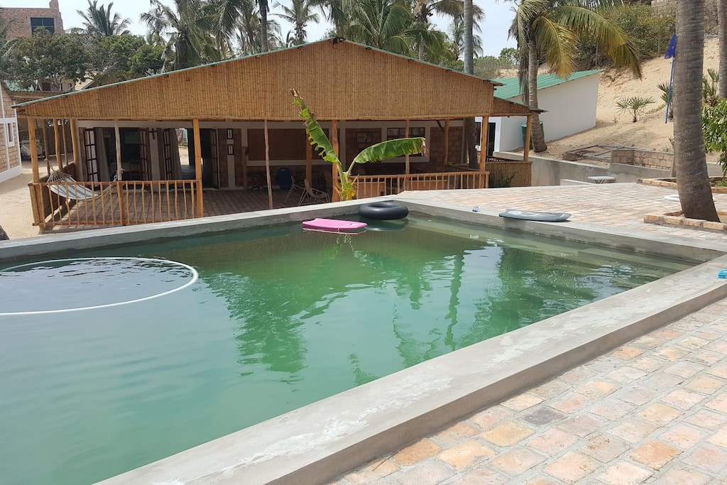 Swimming pool and play area for kids.
