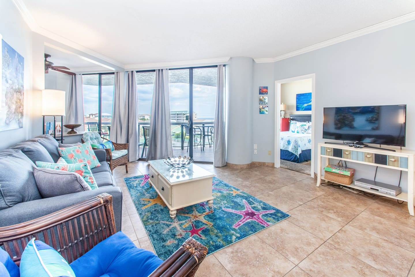 Lovely living area with flat screen and balcony access