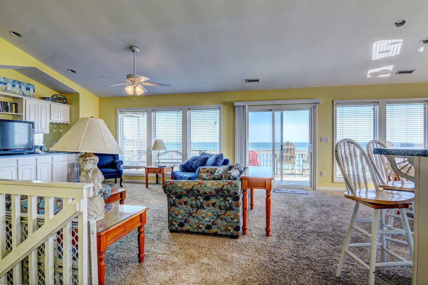 Large living room on top floor & top deck overlooking the beach