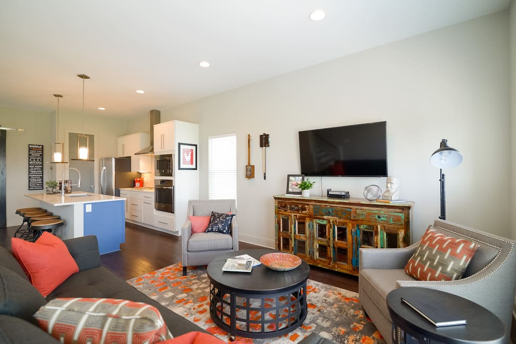Hardwood floors expand the open-concept living room