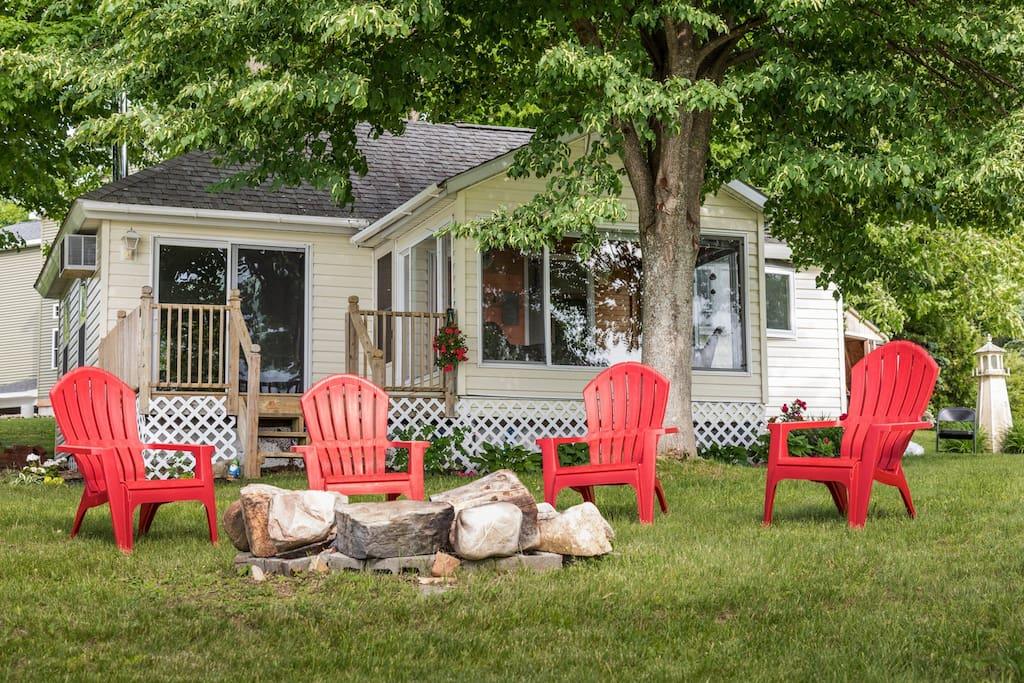 Adirondack chairs around the fire pit