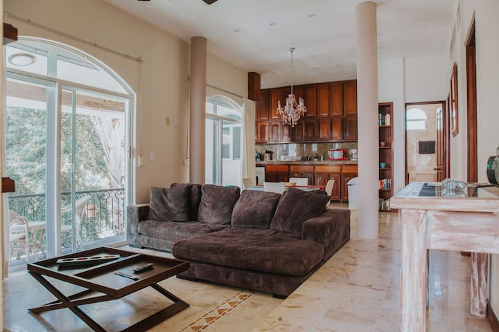 The spacious livingroom with big balcony and kitchen