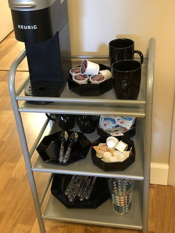 Coffee and fixes for your morning coffee, plates, utensils, glasses and toaster for your bring home food.