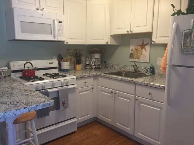 Full size fridge, stove.  Includes most things you'll need to cook or bake.  Also full sets of dishes., glasses, wine glasses, etc.