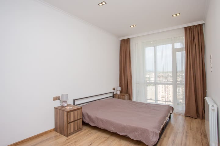 This is big enough bedroom with king size bed and closet drawers and shelfs inside. This bedroom has 50 square feet private balcony.