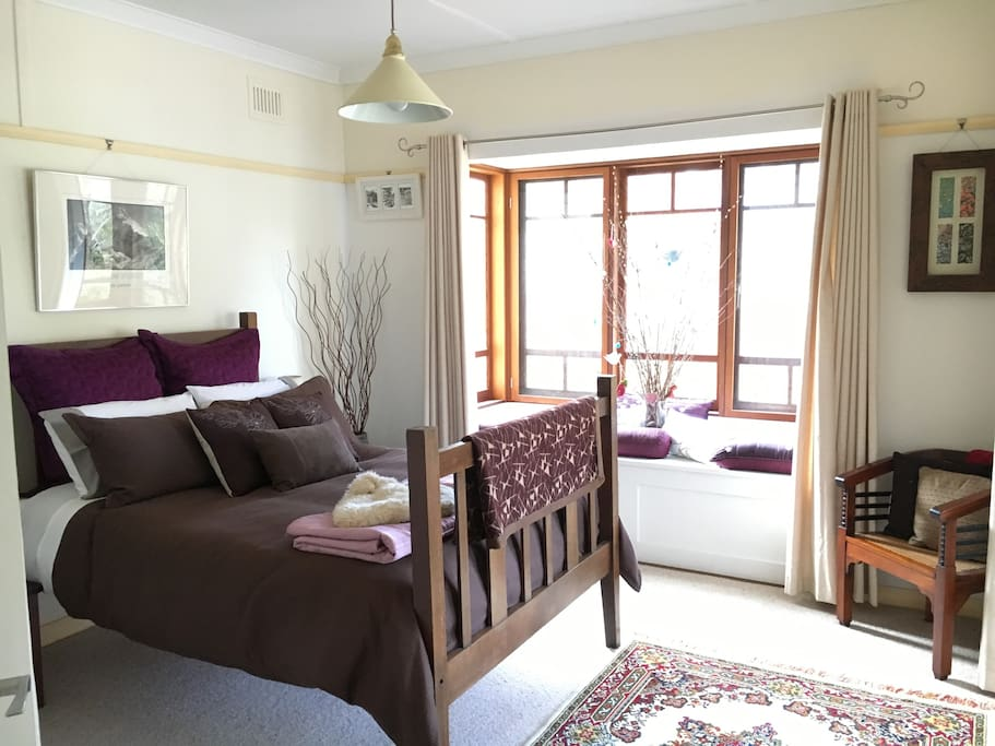Cardamon Cottage large bedroom with sunny bay window