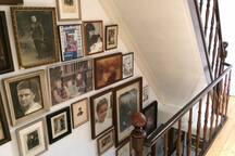 Staircase with family pictures dating back to 1890.