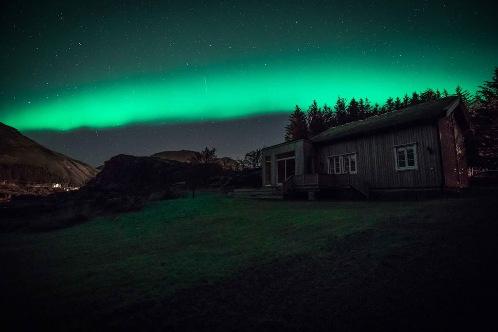The Lodge and garden and the Northern Lights in the background