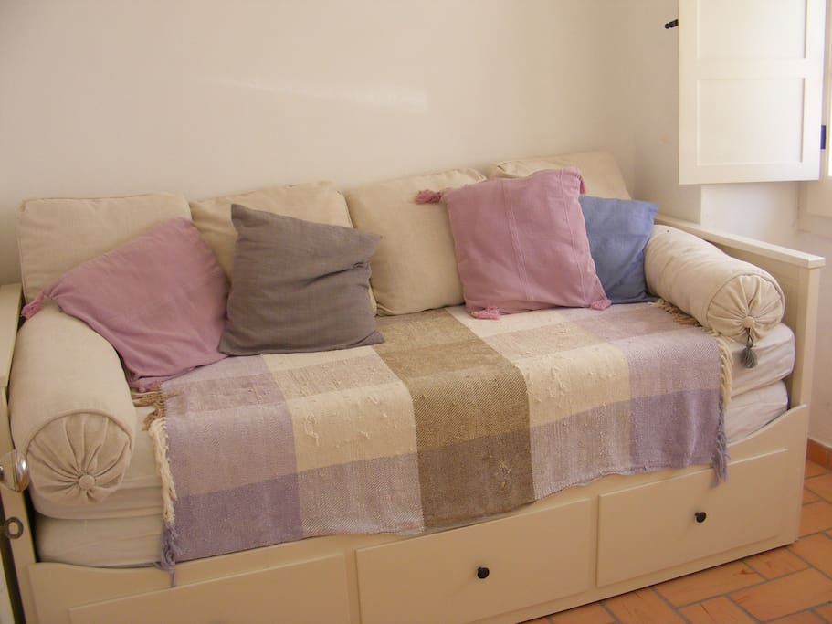 The kids will love this little bedroom with two beds.