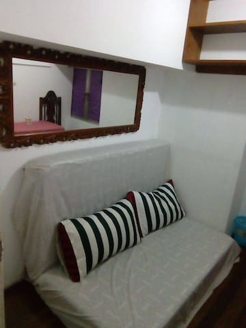 Jibril Room: Ideal for  person, fully air-conditioned, with WiFi, open shelves, table & chair and large mirror.