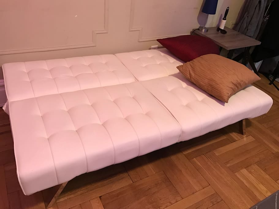"One of the futons fully reclined - it is 5',11"" long. The other futon is an exact match."