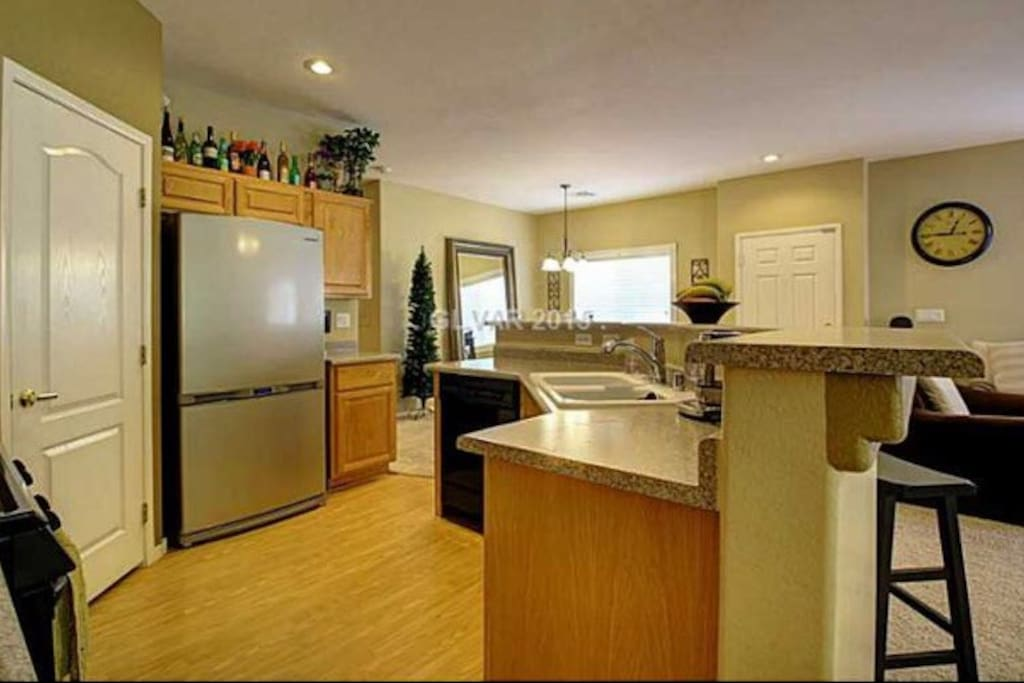 Full kitchen side view of amenities listed