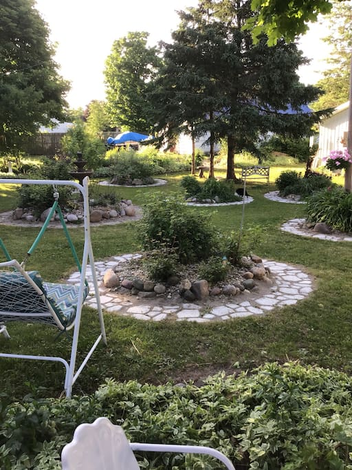 Outside the camper, you can enjoy a peaceful garden, swings, a deck with a cup of coffee, while you relax.
