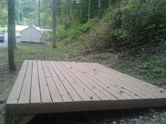 Camping platform #1. Elevated 10' x 14' wood platform. The View is looking back up towards Glamping tents and Lodge with Camp bathrooms